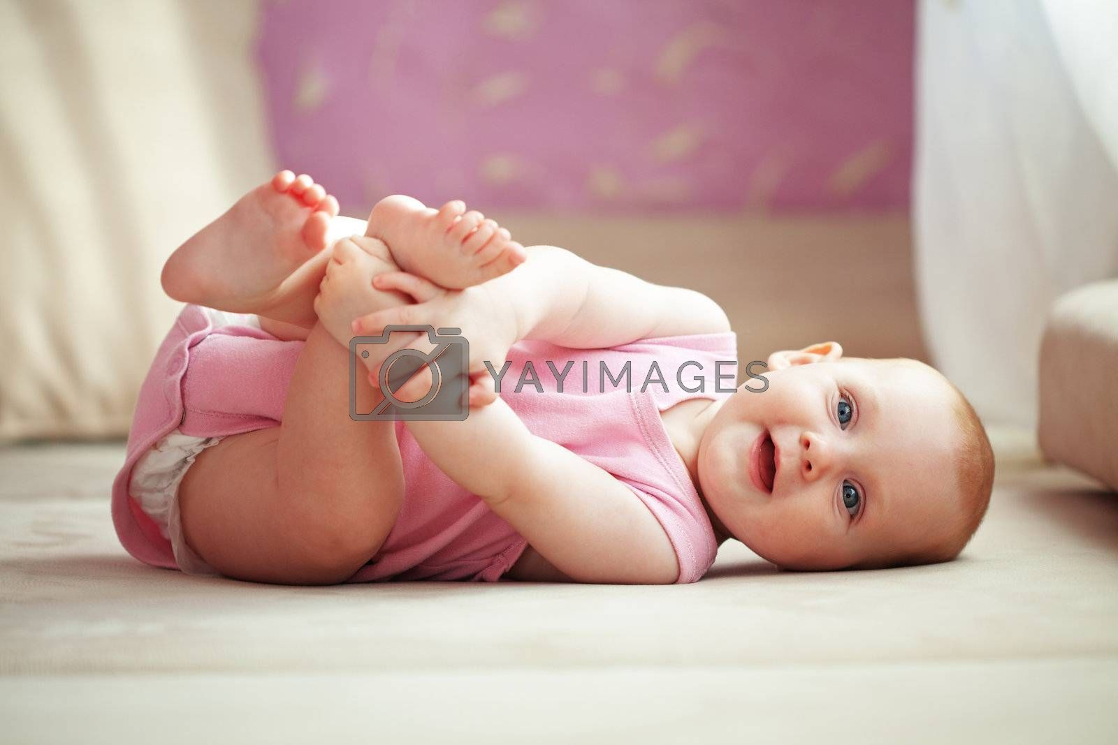 Picture of a baby lying in bed