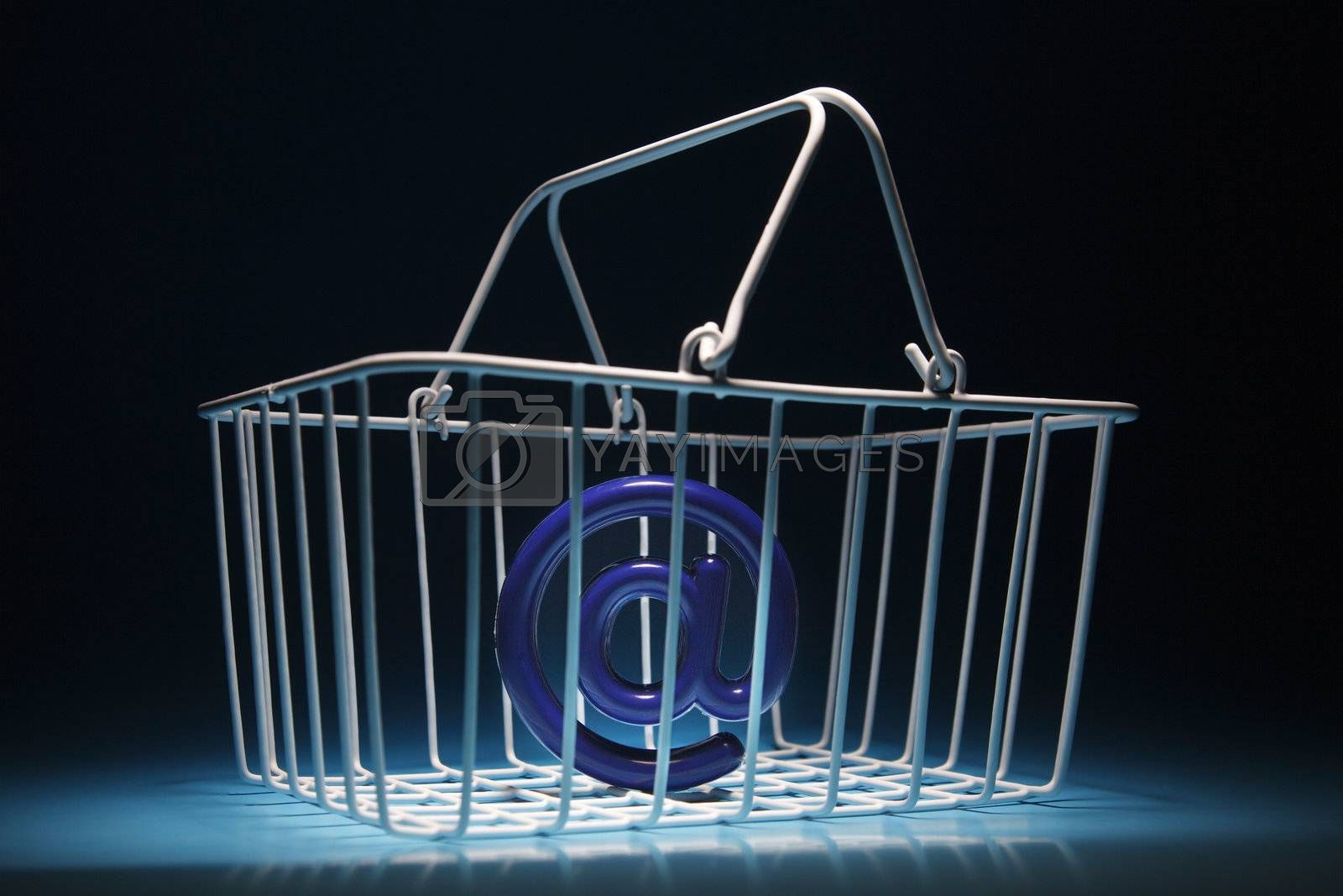 online shopping concept basket with computer symbol