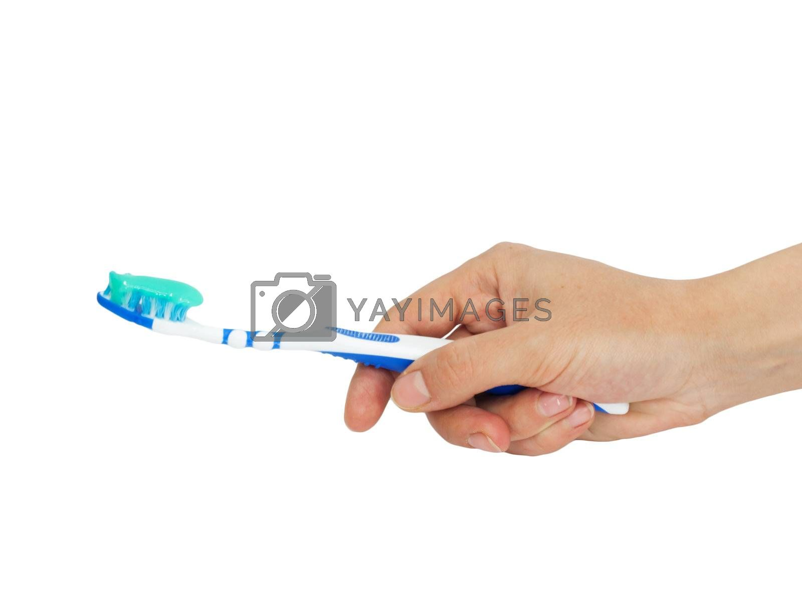 Toothbrush and toothpaste in a hand