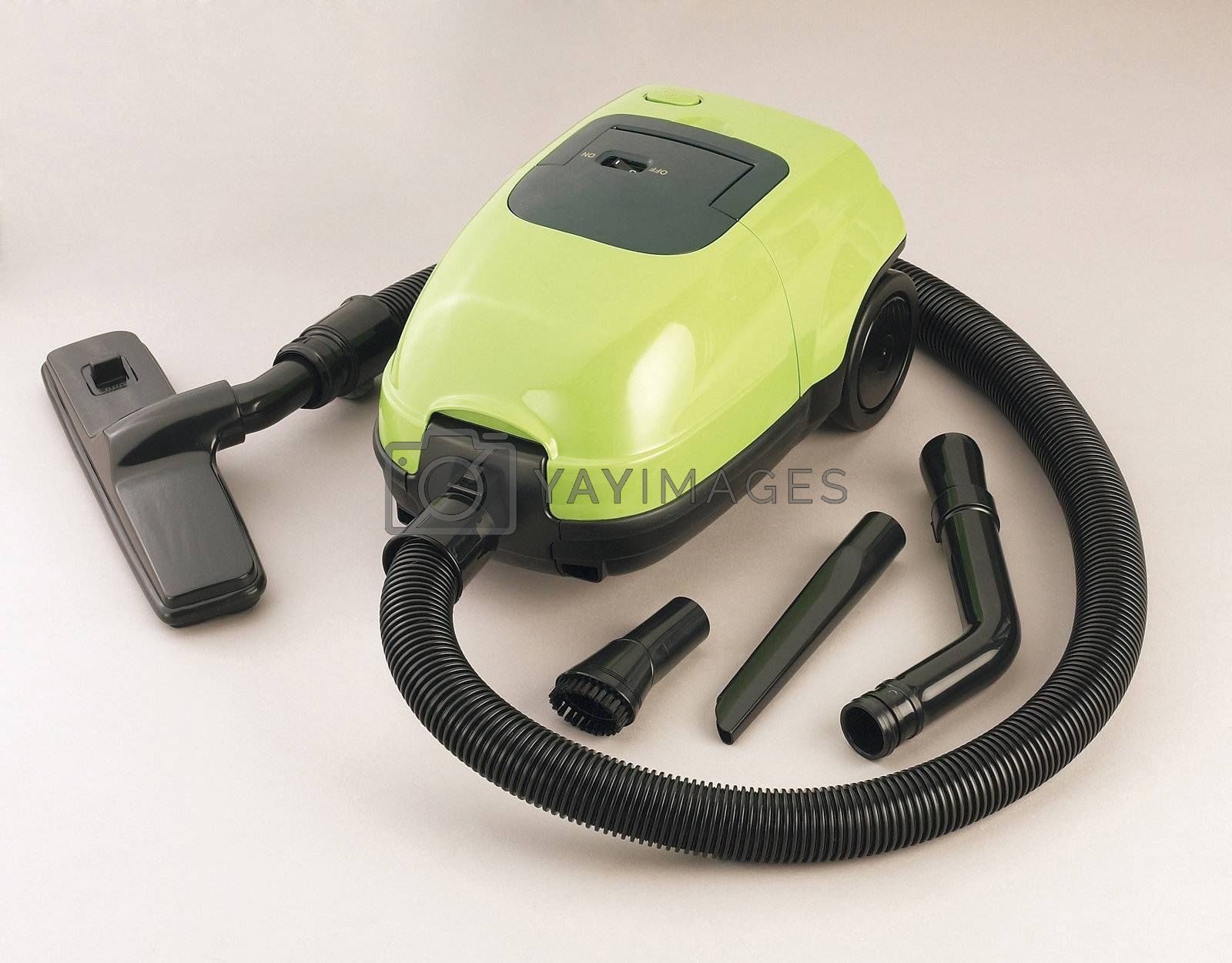 A green vaccum cleaner isolated.
