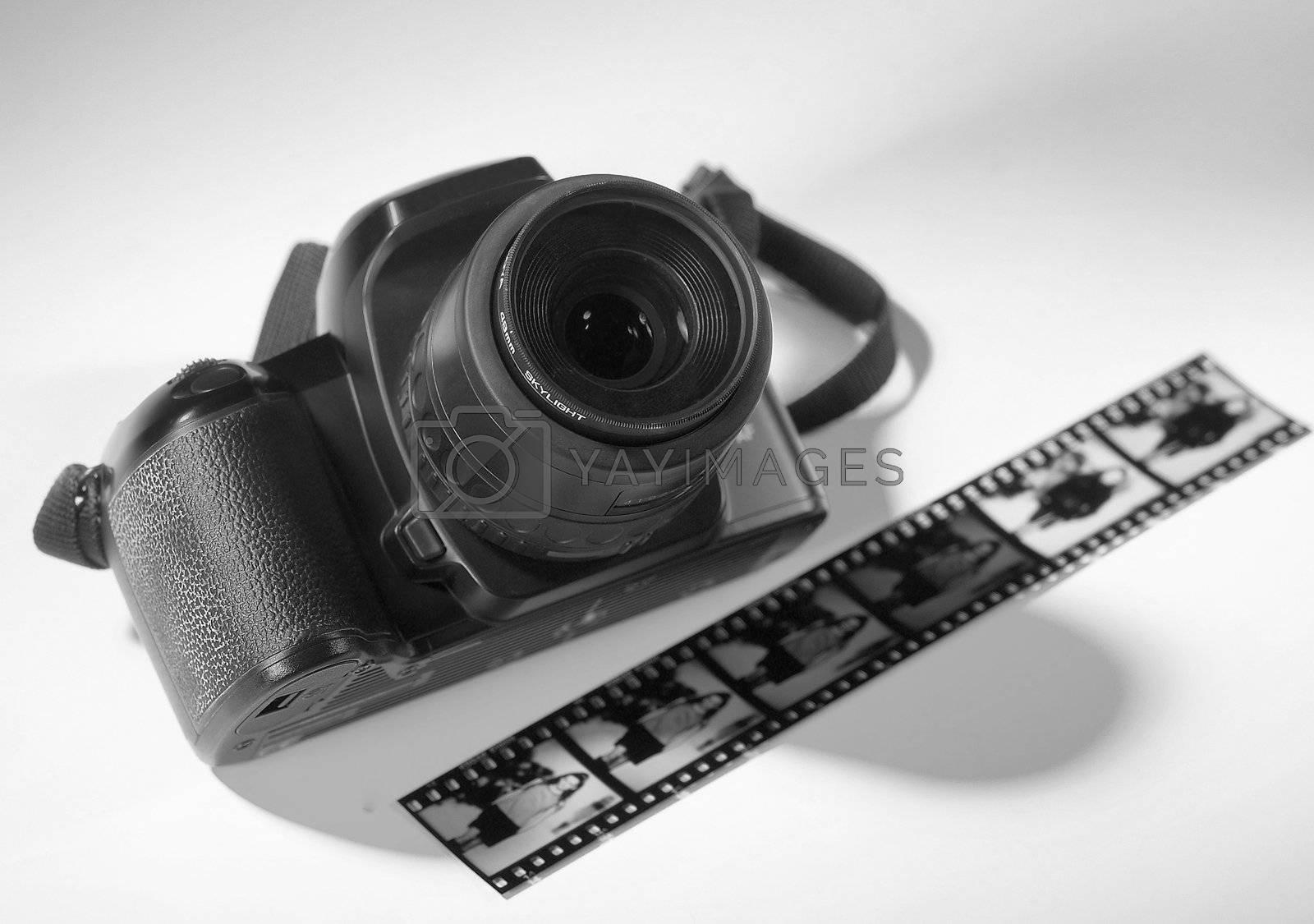 Black camera with a strip of film.