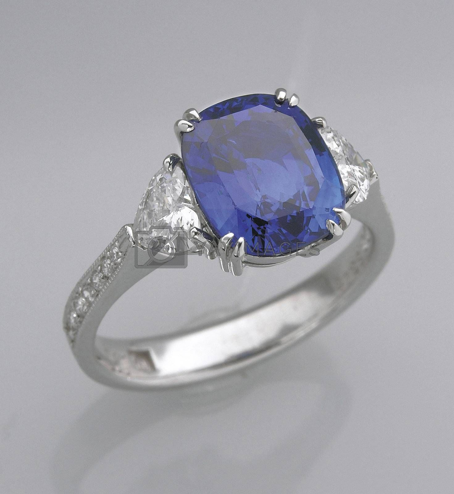 A sapphire ring on the table.
