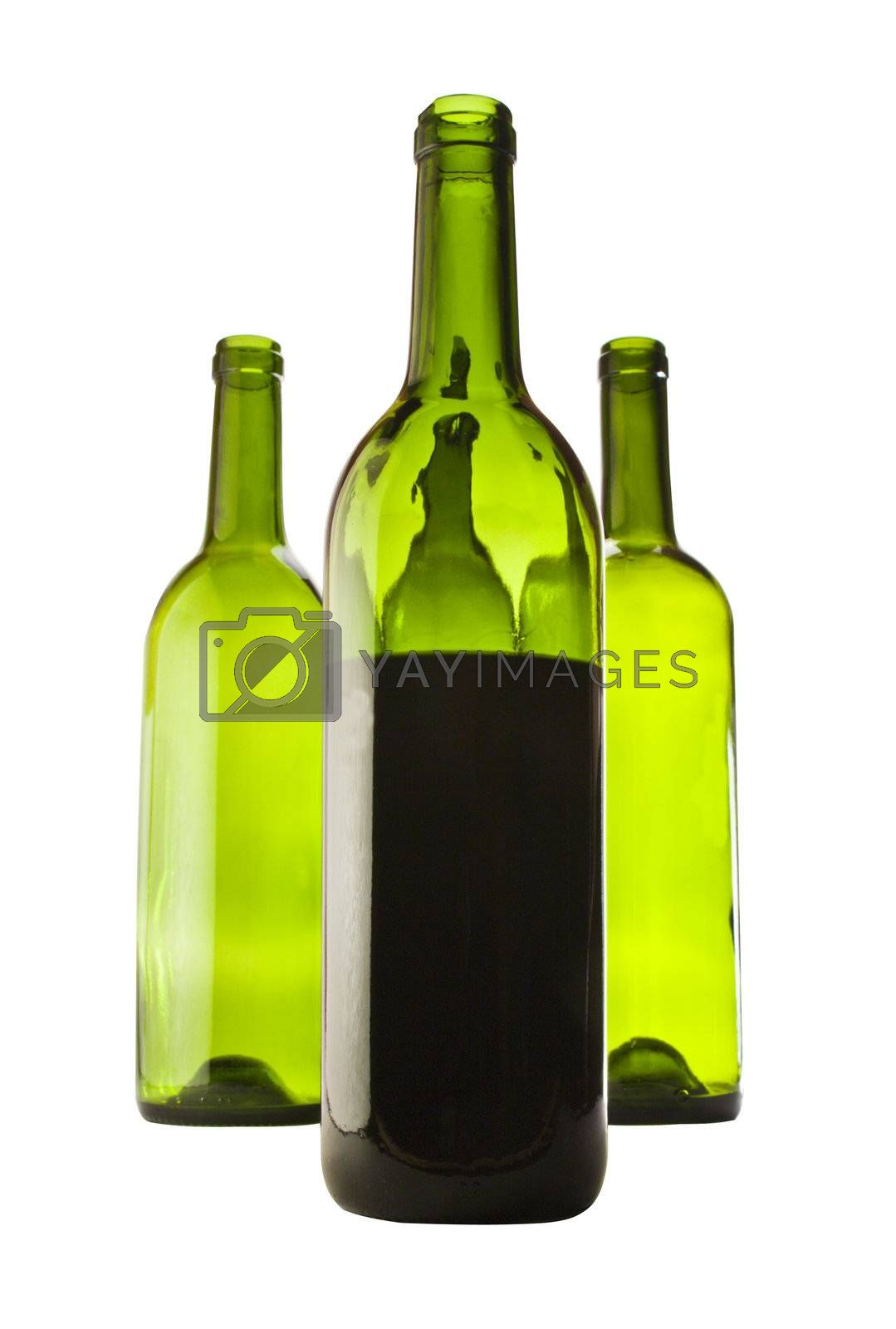 four bottles of wine isolated on a white background