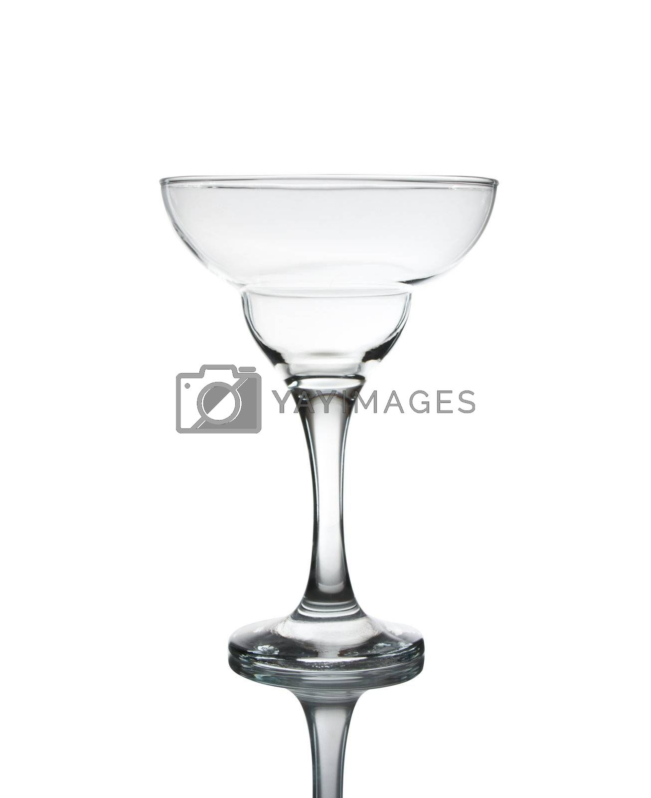 Empty cocktail glass on white ground