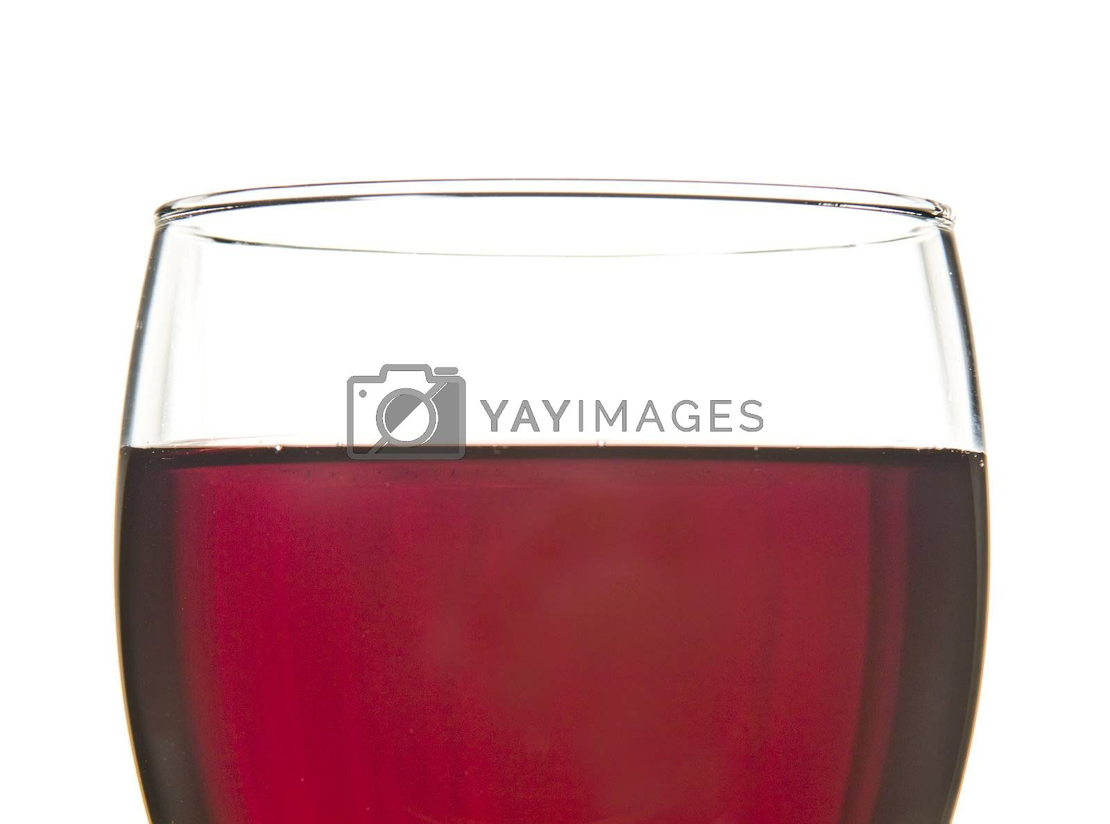 Closeup of a glass of red wine, with white background.