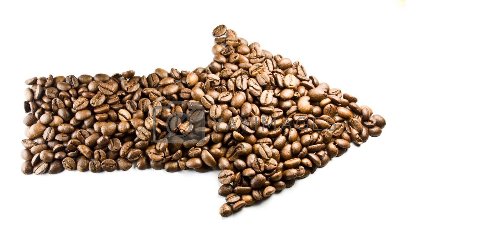 arrow made from coffe beans, on white background