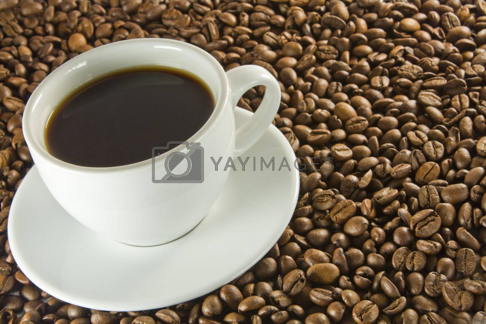 Coffee Beans and cup of black coffee.
