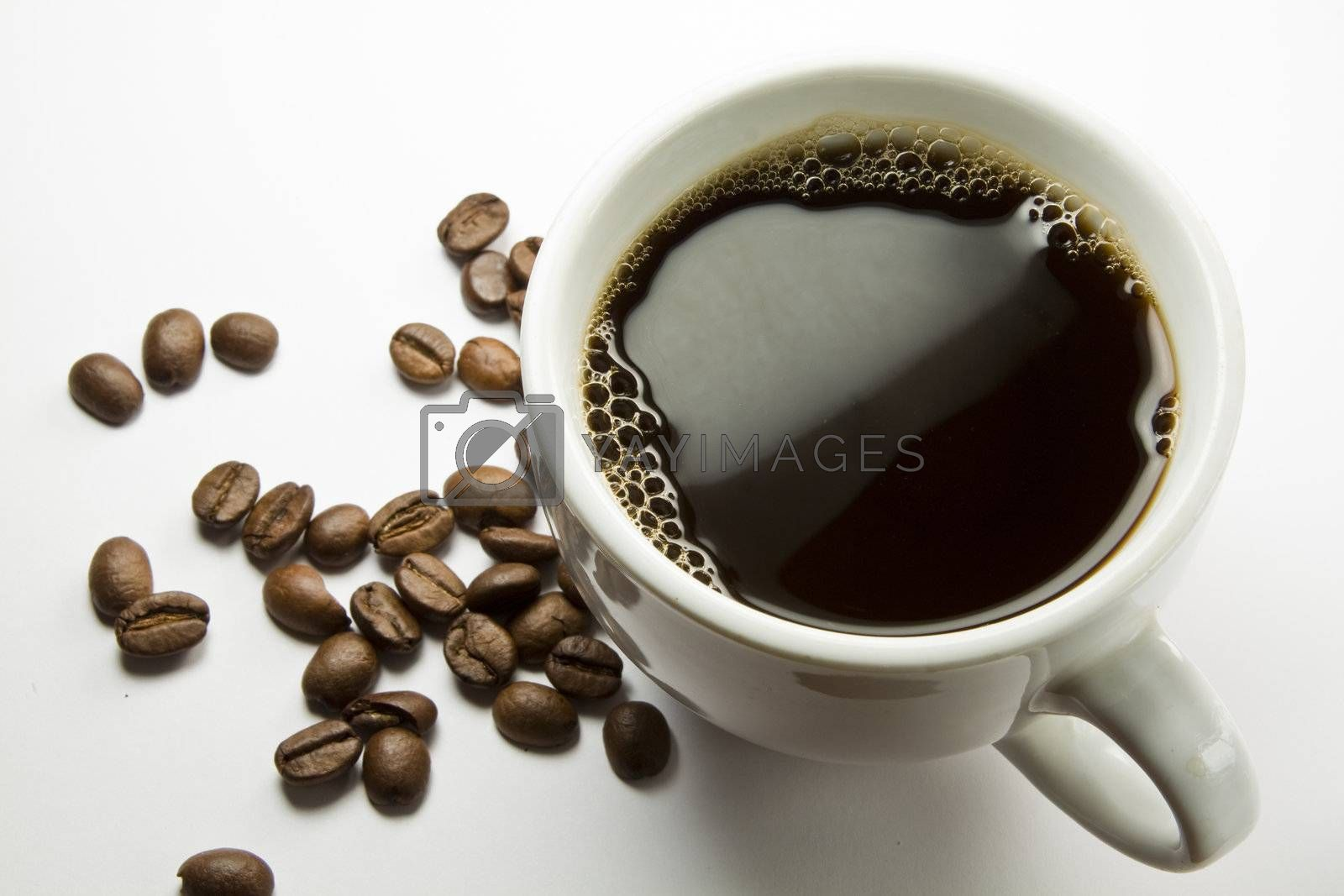 The cup of coffee and beans, isolated on white background.