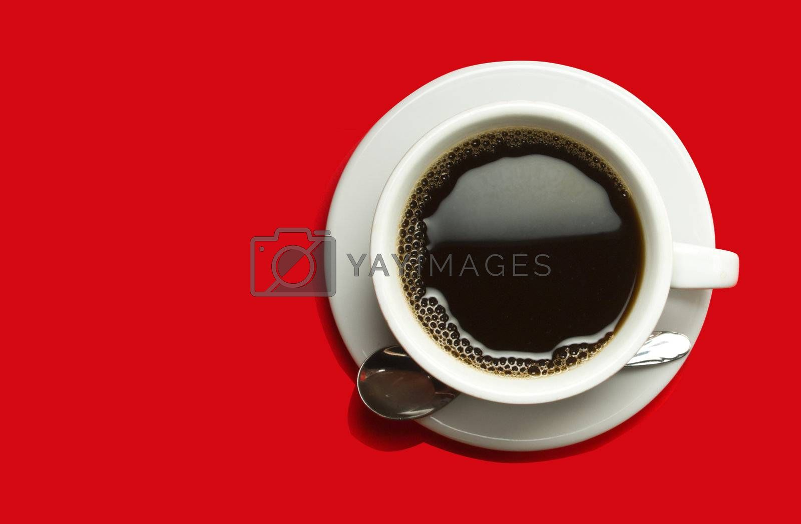 Picture of black coffee in a white cup on a red background