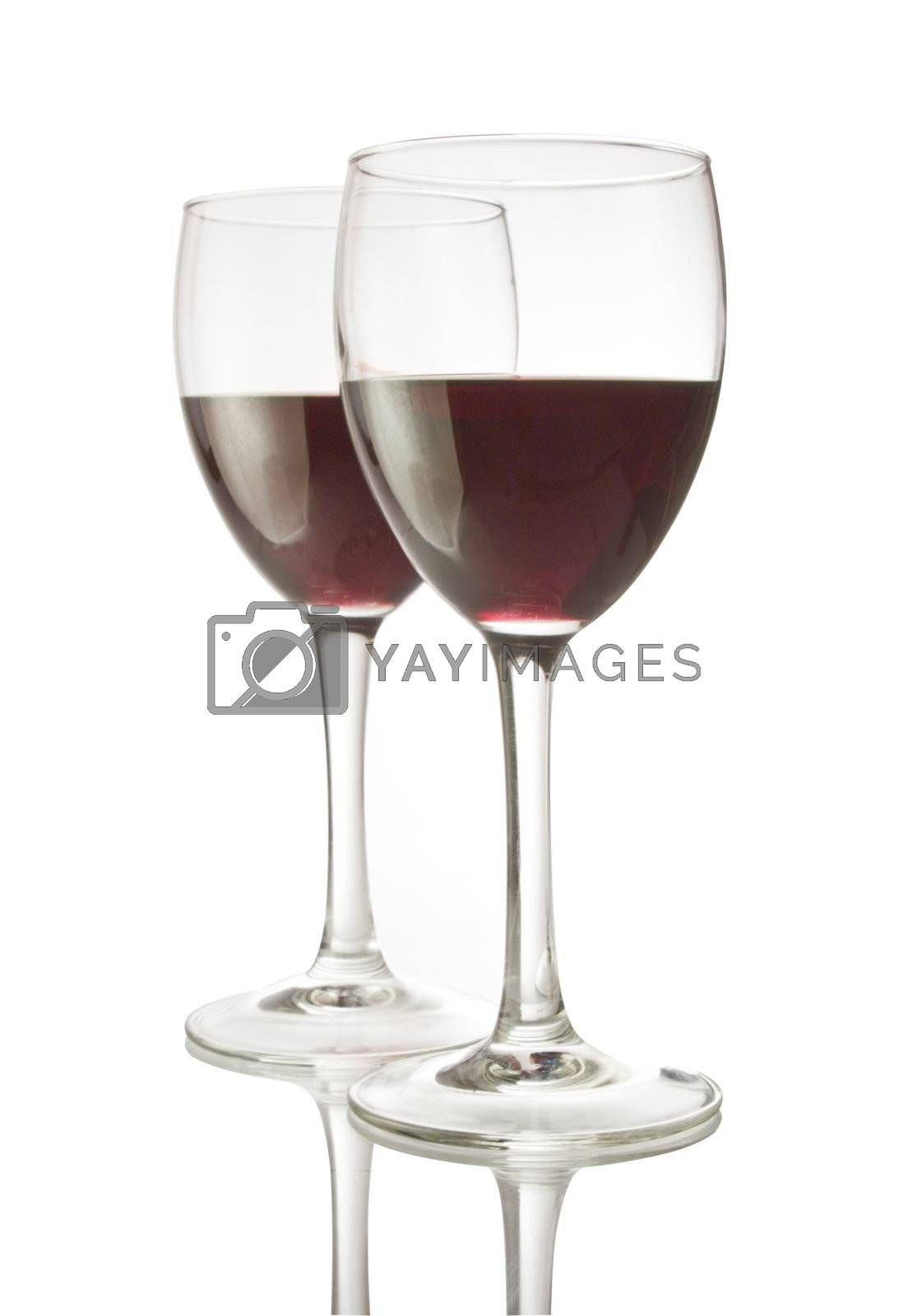 Two wineglasses filled with red wine, isolated on white with clipping path.