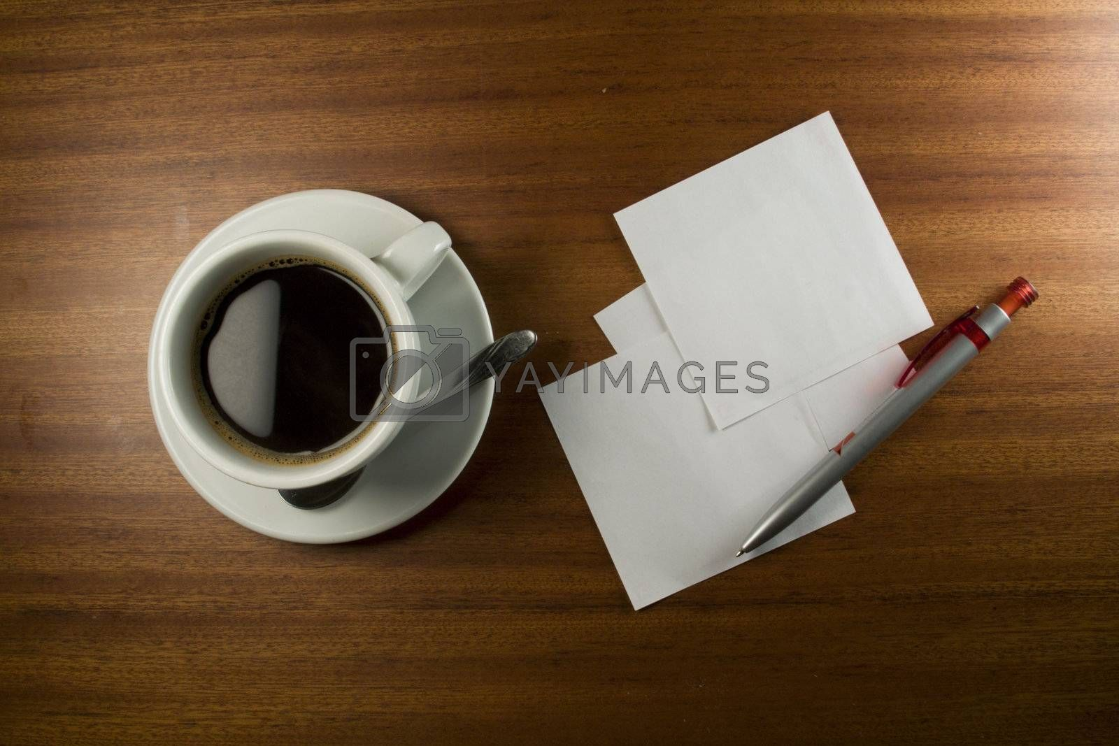 Note Card, Pen and Coffee Cup on Wood Background.