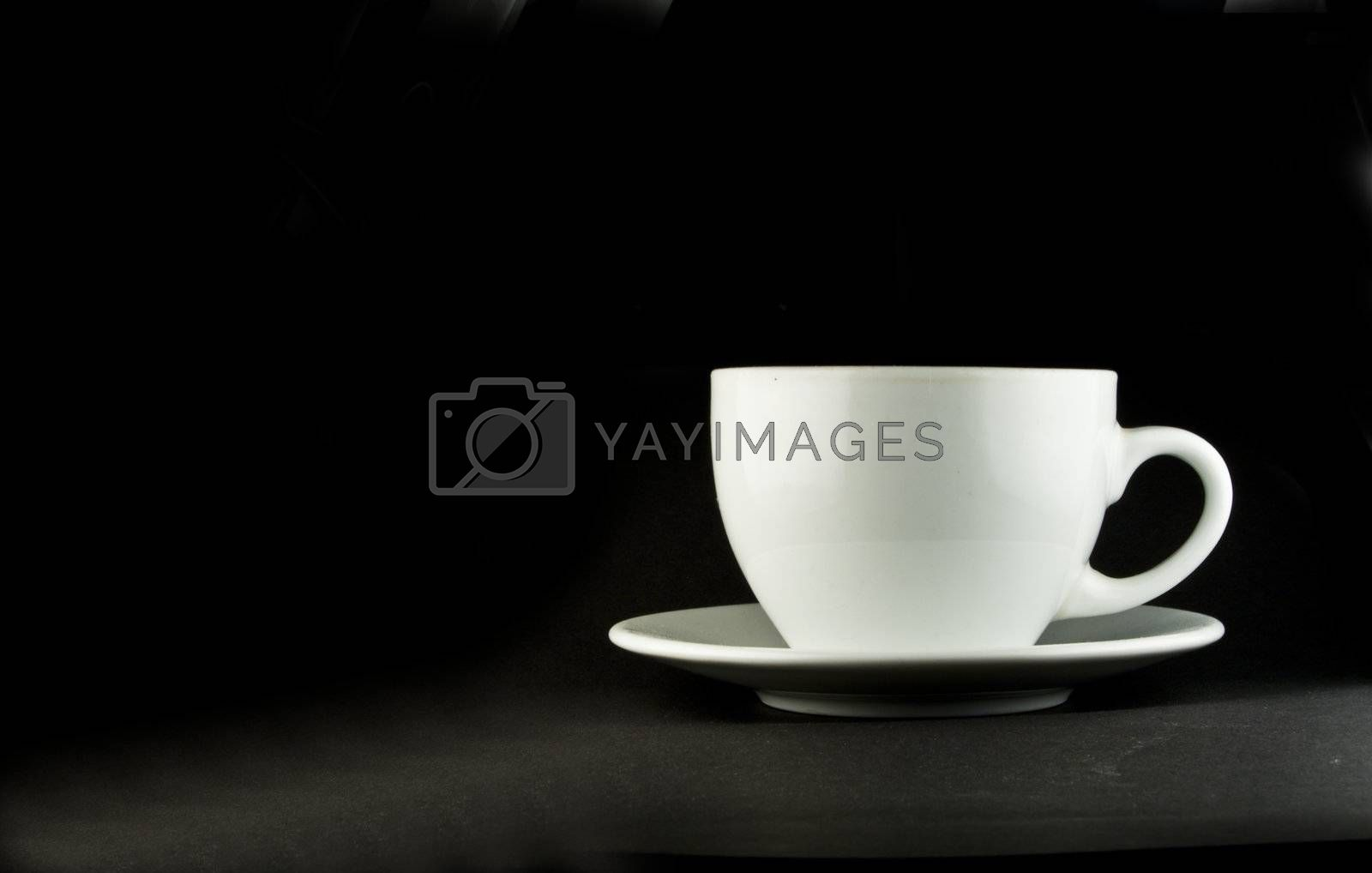 Perfect white coffee cup on a black background