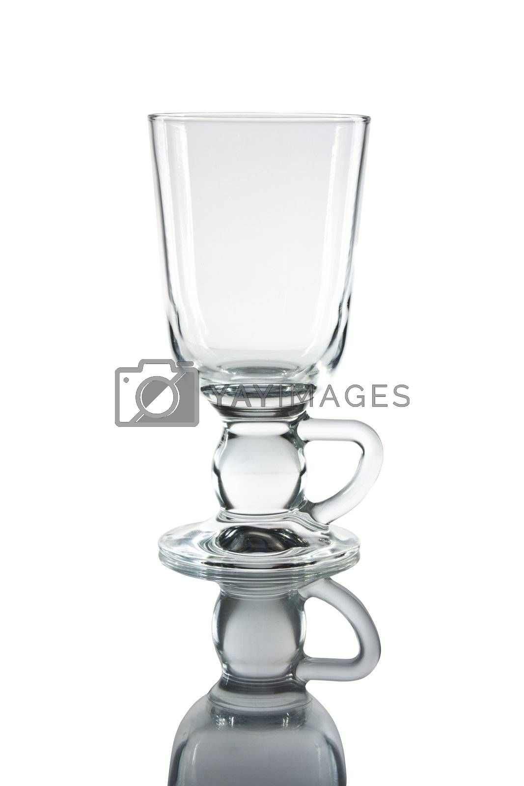 Glass of martini with reflexion on a white background.