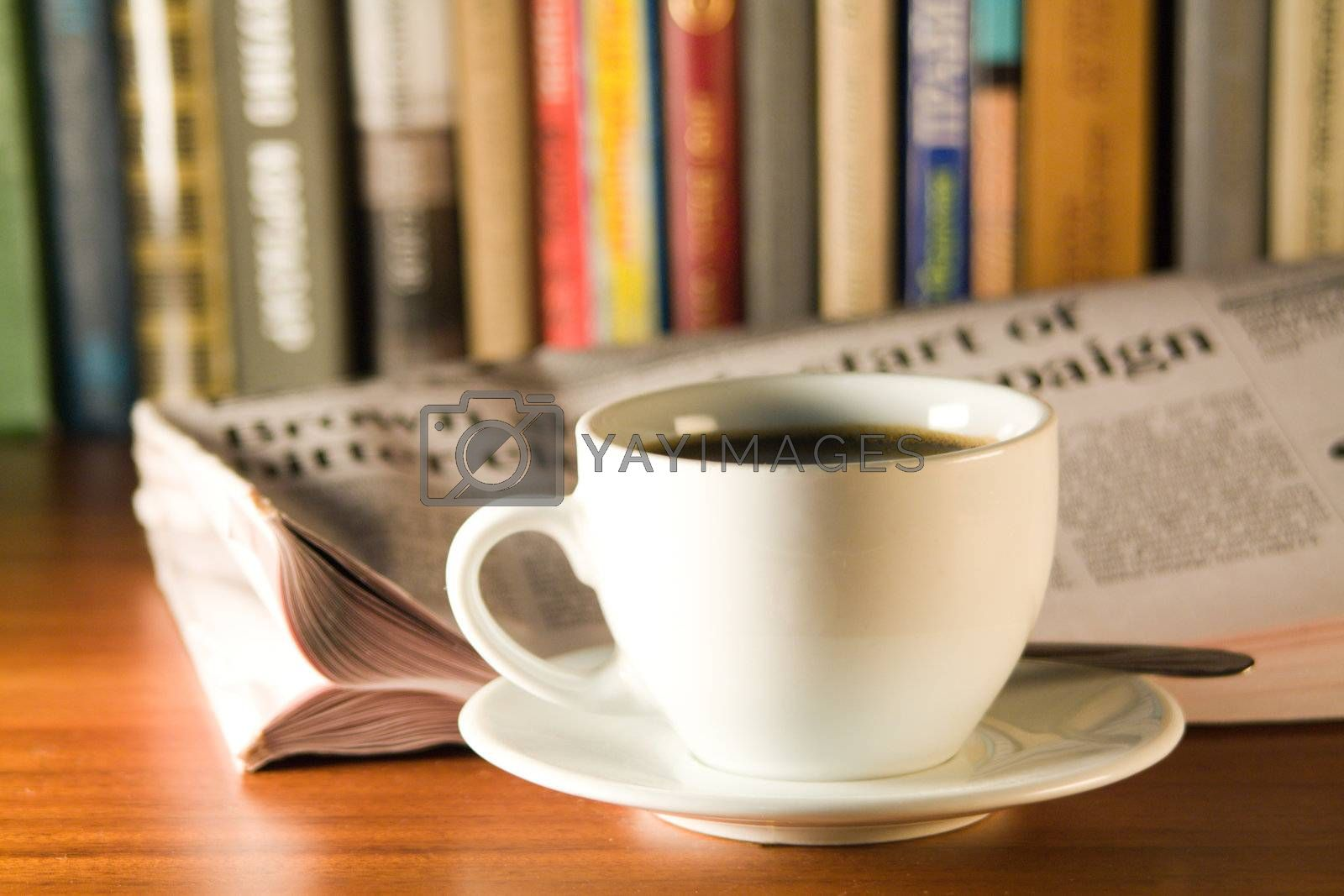 Coffee and books on a wooden table. Small depth of sharpness.
