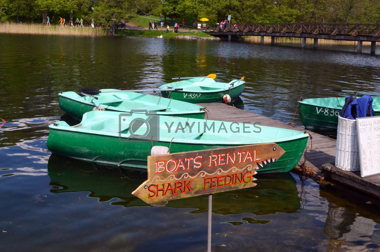 Boat rent near shore of Lake. Active outdoor recreation. Trakai, Lithuania.