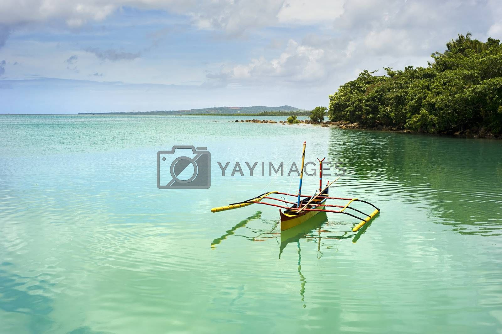Tropical landscape with traditional Philippines boat on Calicoan island, Philippines