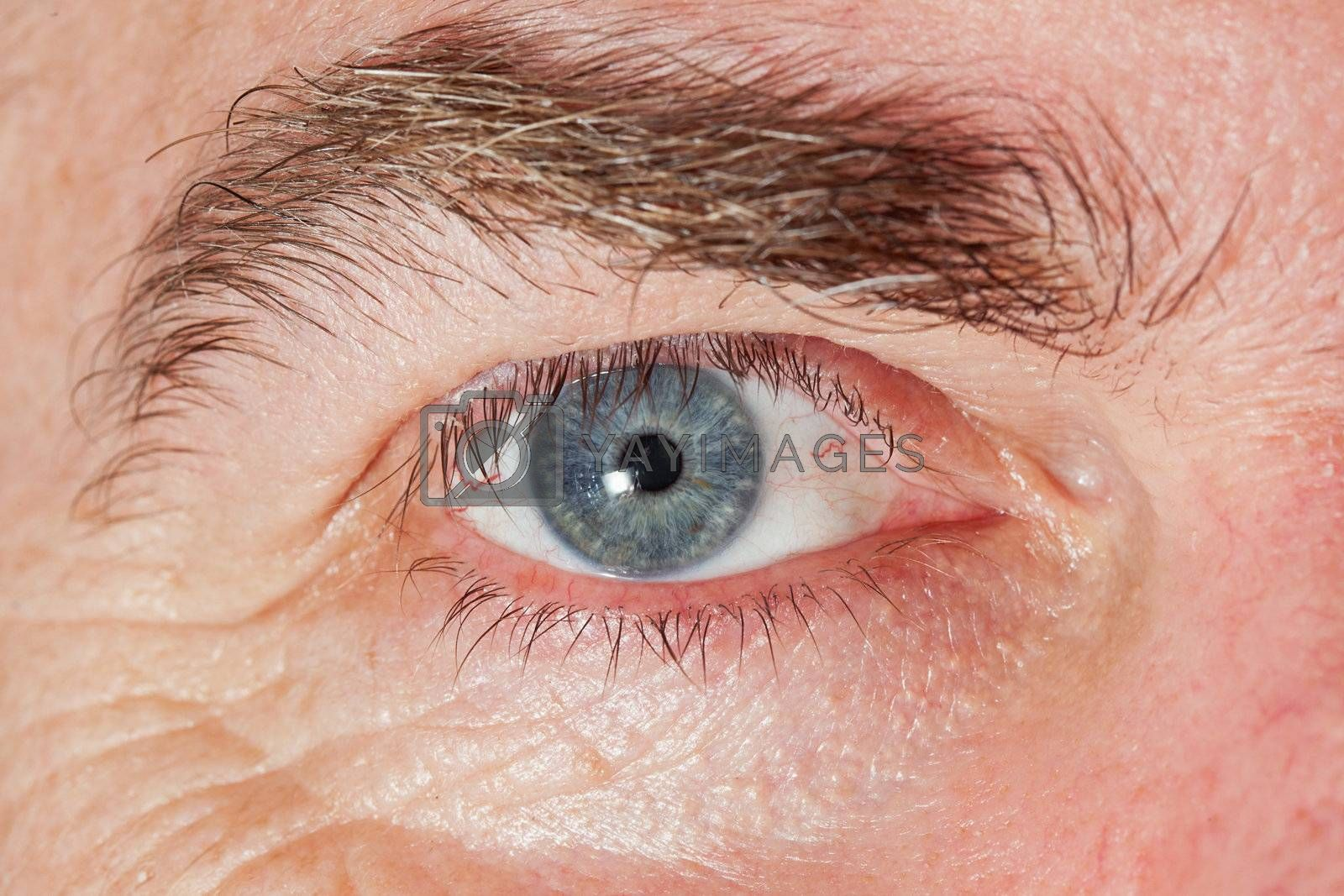 Blue Eye of mature man, close-up horizontal shot