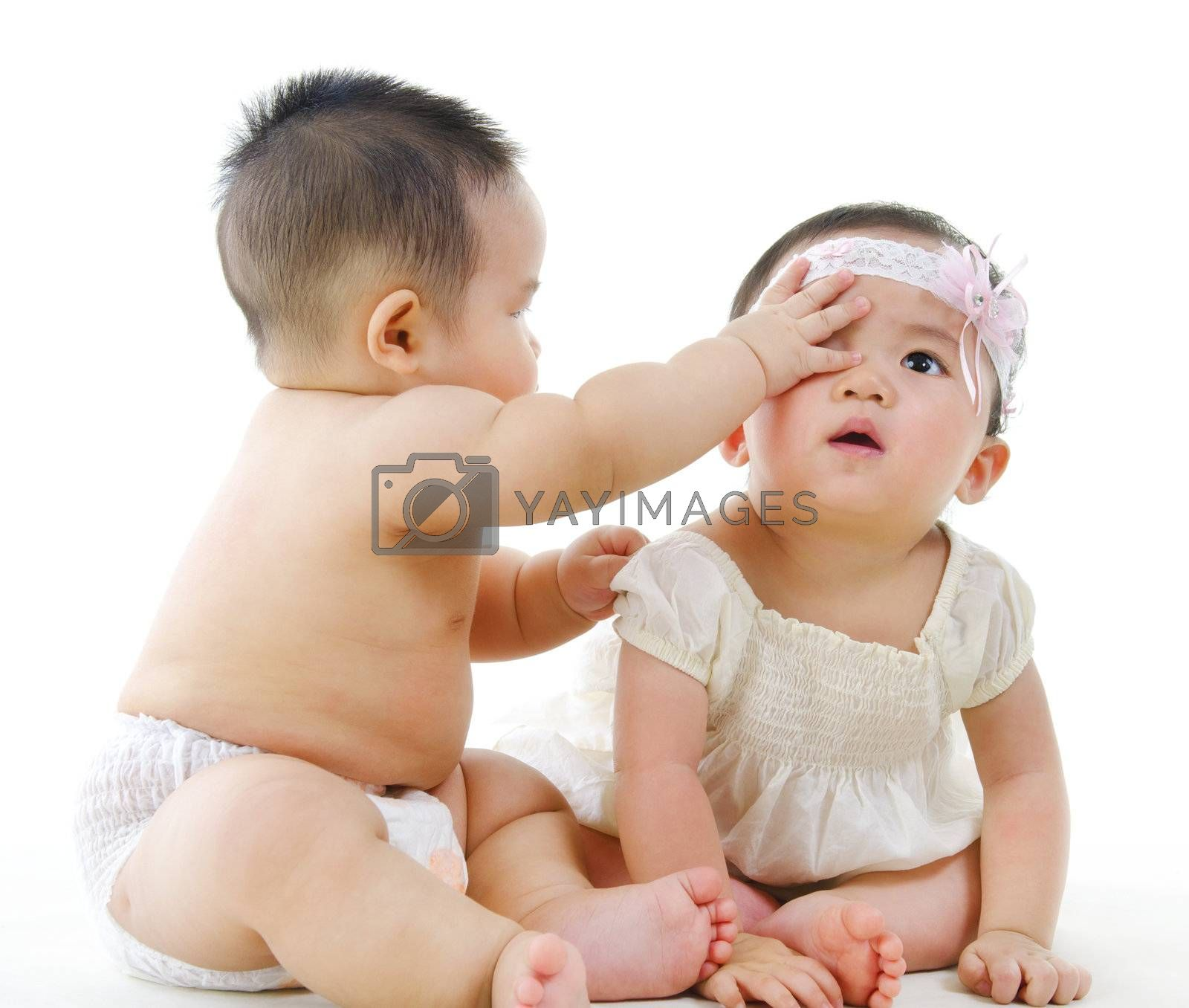 Two Asian babies sitting on white background
