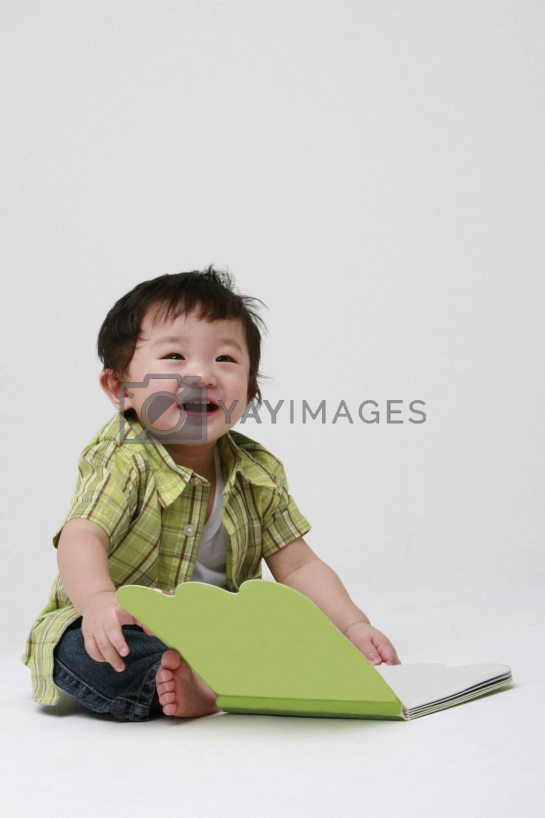 Cute toddler with a book