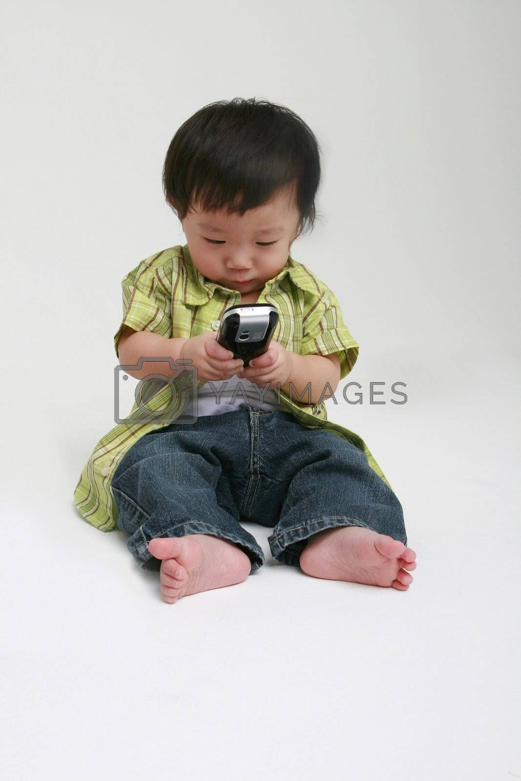 Cute toddler with a mobile phone