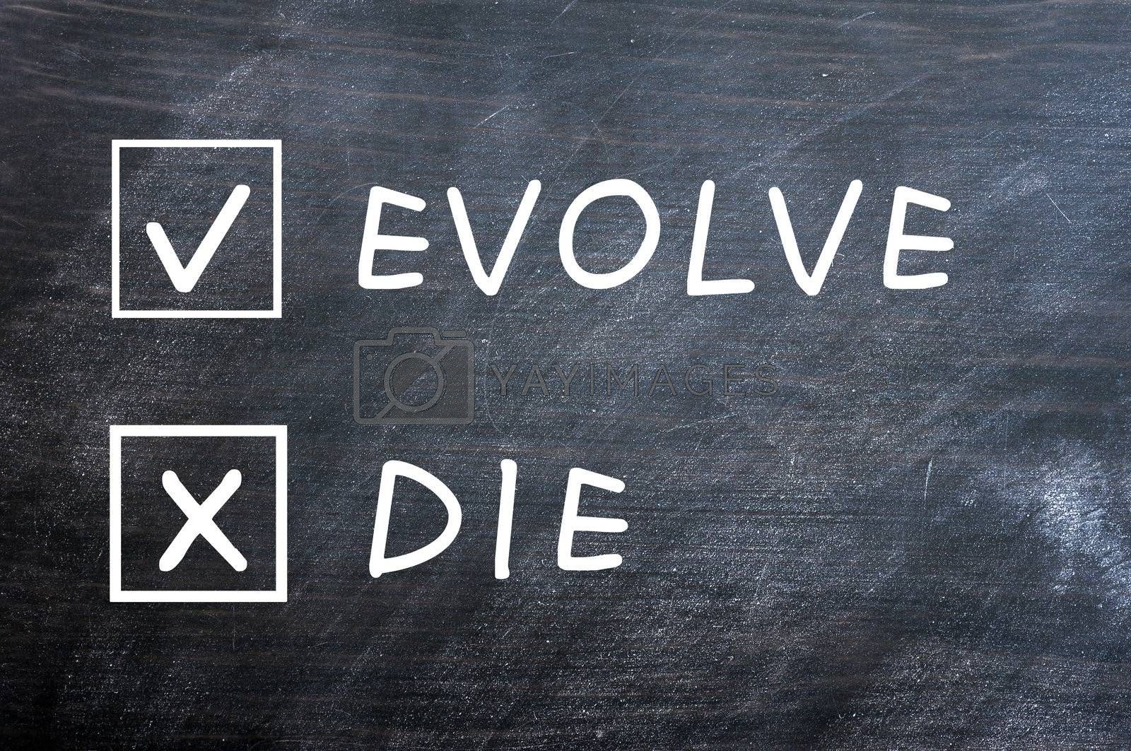 Evolve or die with check boxes drawn with chalk on a smudged blackboard