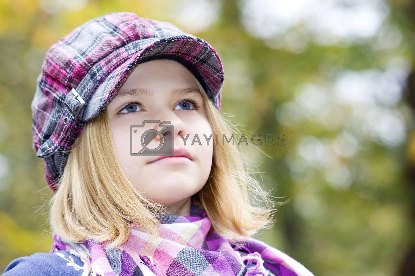 Autumn portrait of a lovely little girl