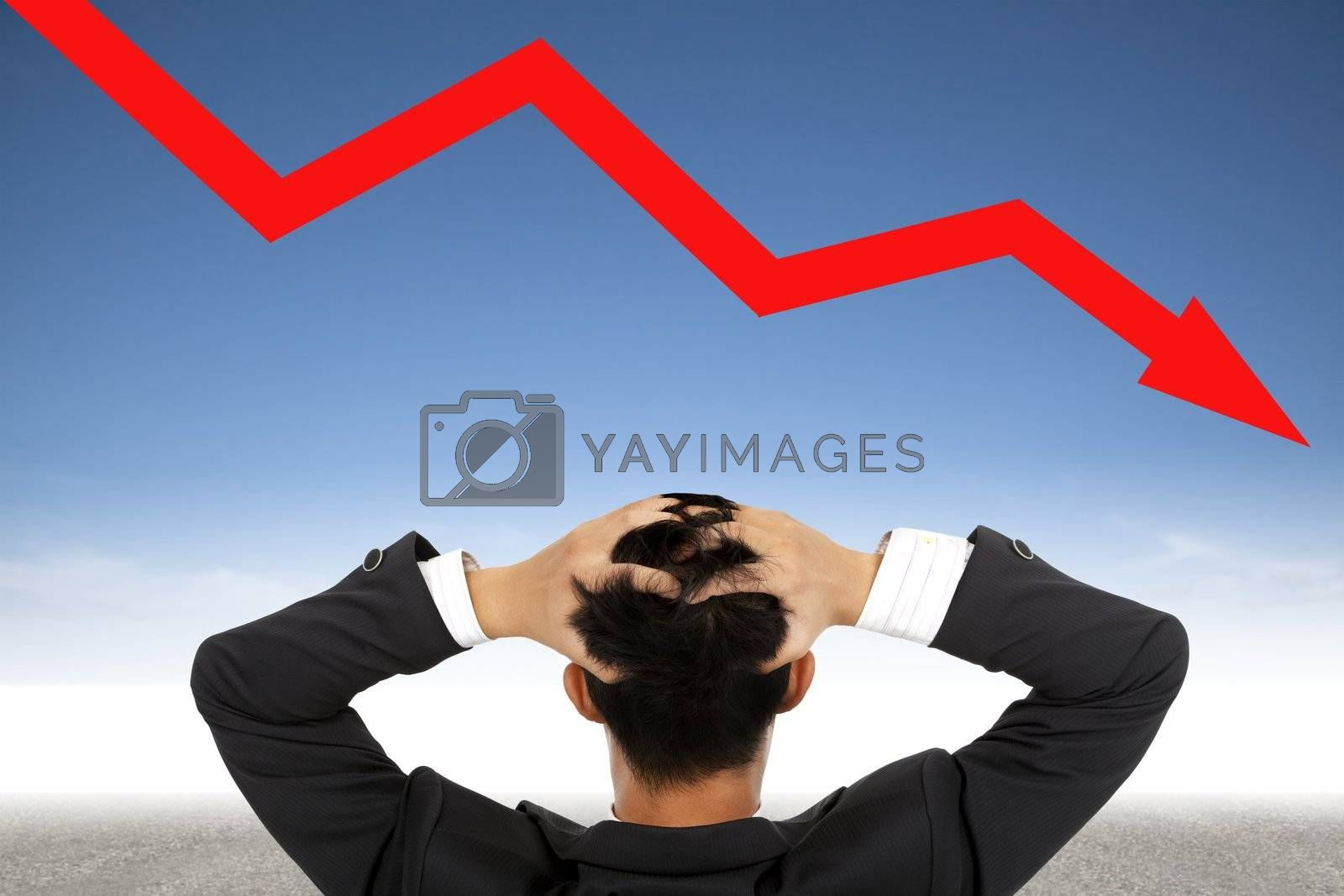 Royalty free image of depression businessman watching  falling financial line by tomwang