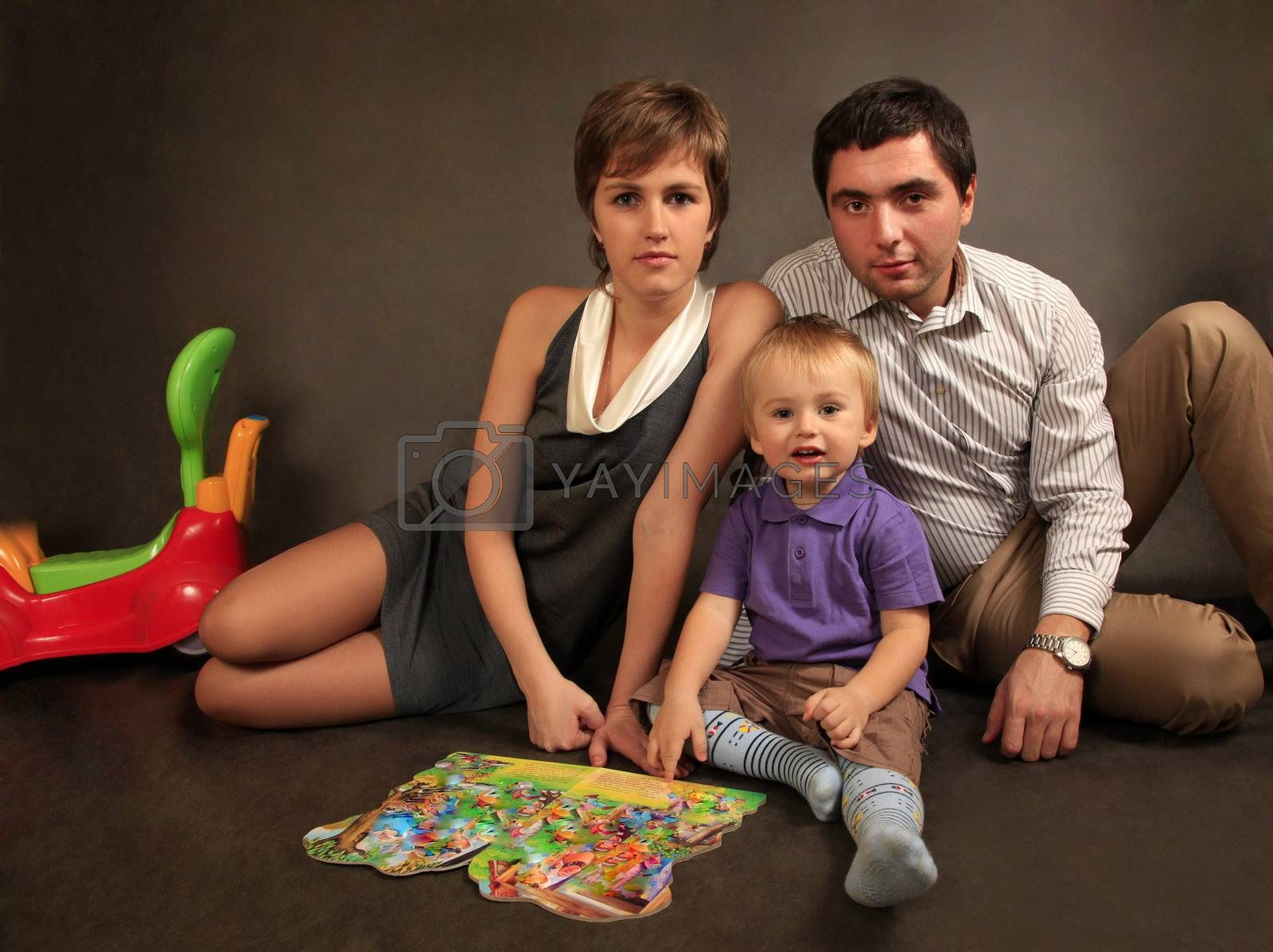 Happy young family with son in studio