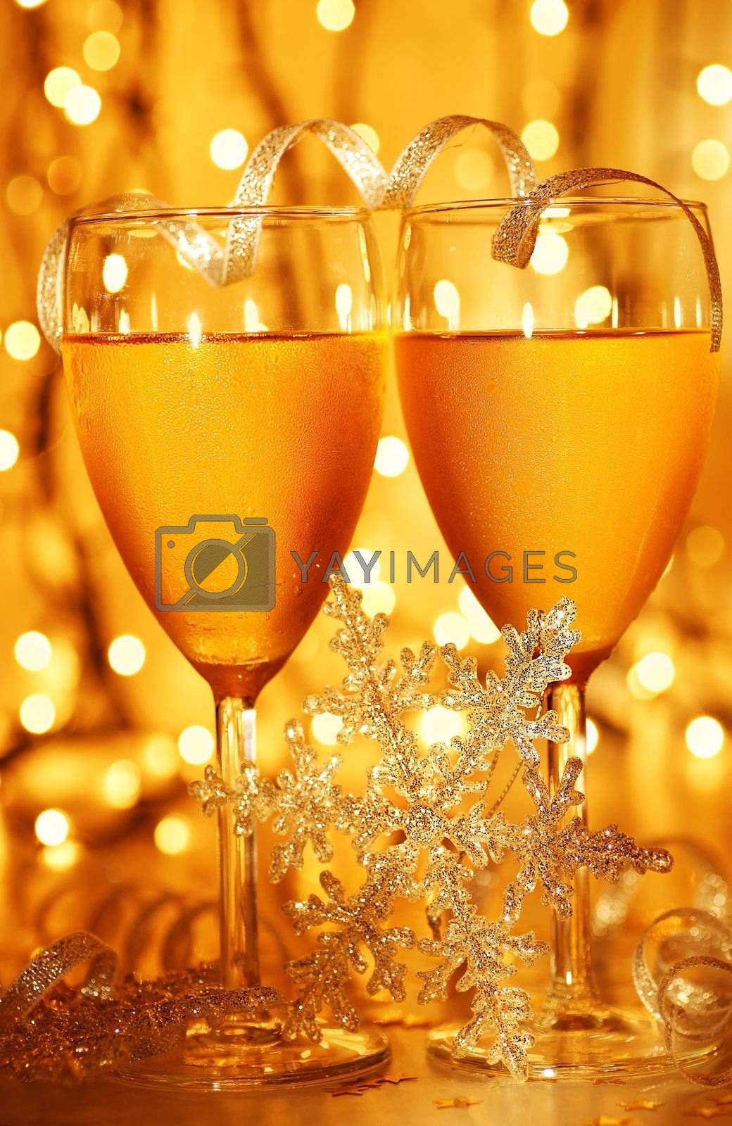 Romantic holiday dinner, celebration of Christmas or new year eve, party with Champagne and festive gold ornament decoration
