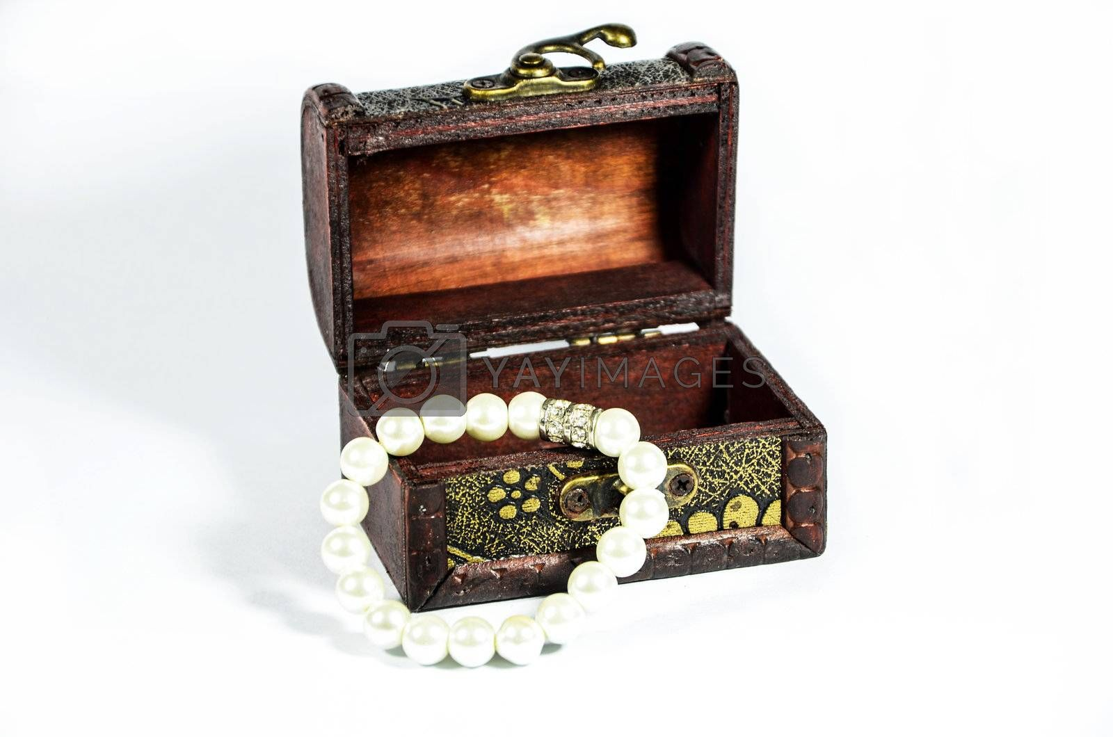 Steel box with pearls on white background