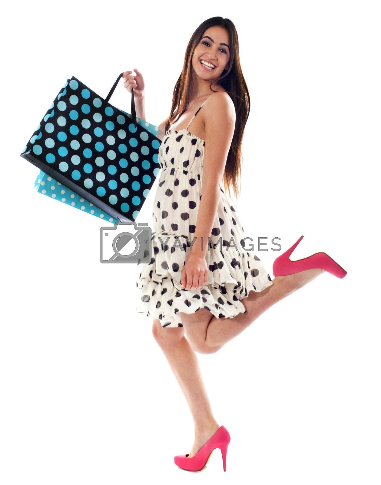 Cute American woman with shopping bags. Smiling and having fun