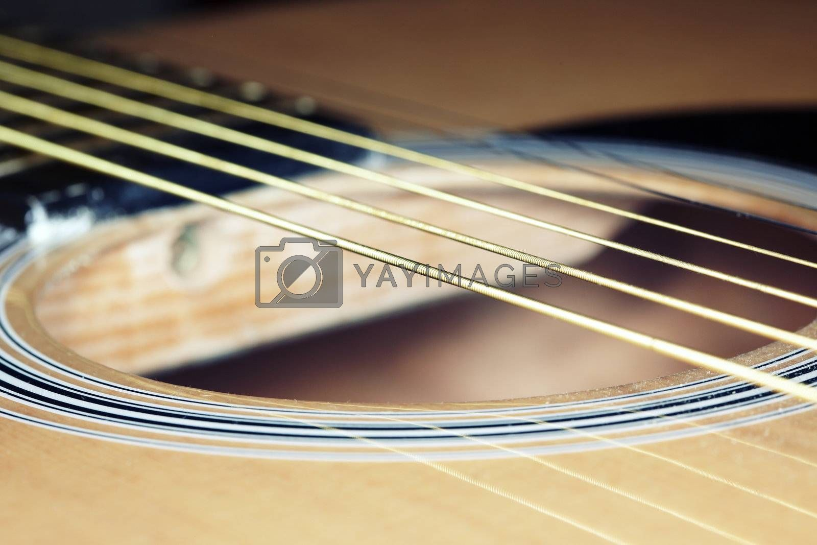 Old acoustic guitar strings. Horizontal close-up photo with shallow depth of field
