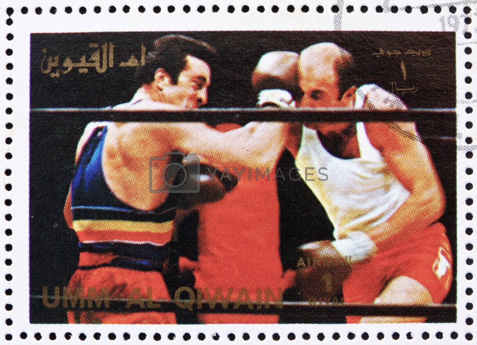 UMM AL-QUWAIN - CIRCA 1972: a stamp printed in the Umm al-Quwain shows Boxing, Olympic Sport, Olympic Games of the past, circa 1972