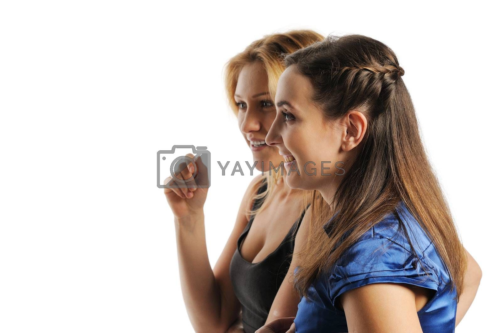 Two young attractive women discussing, look to the left. Isolated on white.