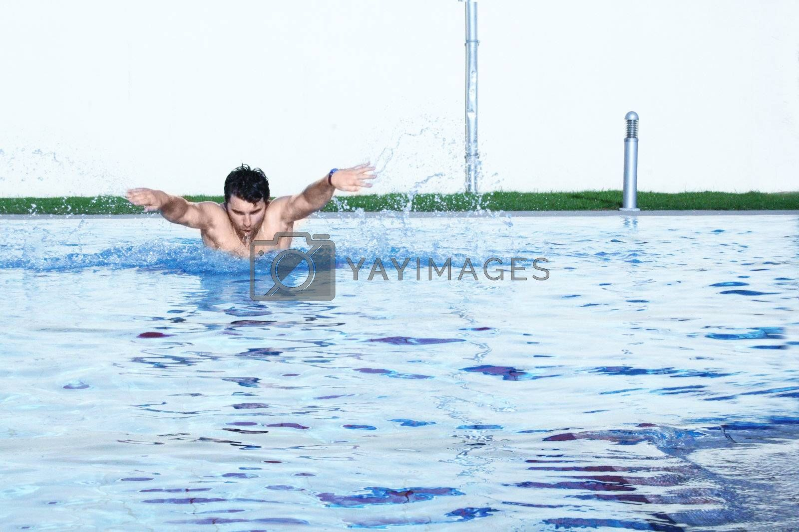 man swims in swimming pool