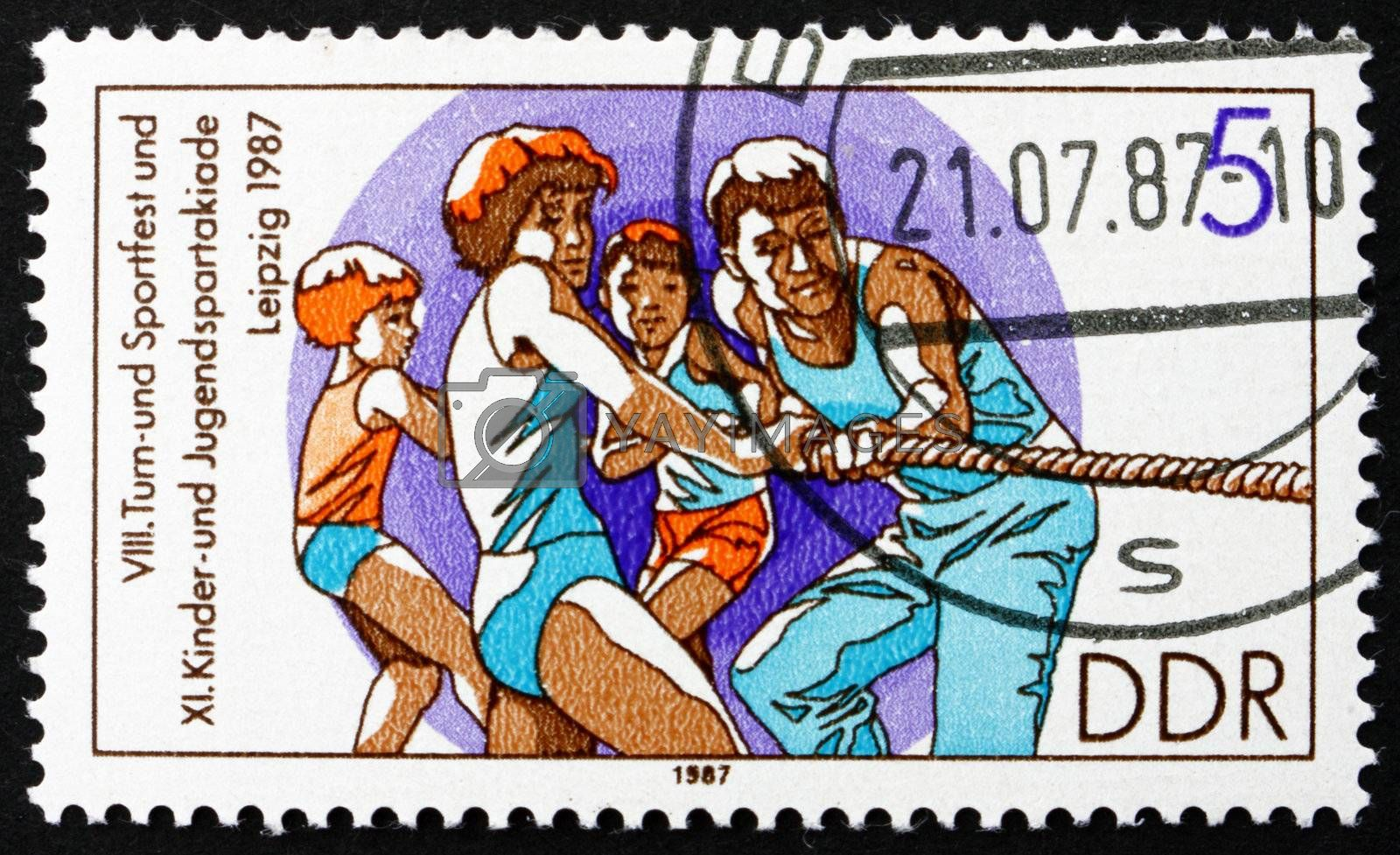 GDR - CIRCA 1987: a stamp printed in GDR shows Tug of War, 11th Children�s and Youths� Spartakiade, circa 1987
