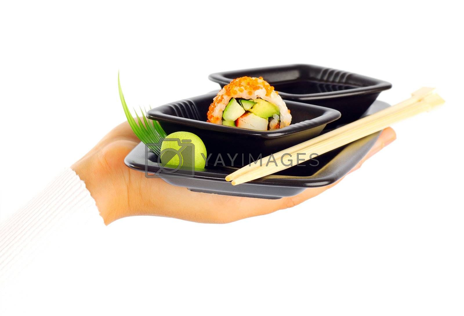 Waiter's hand isolated on white background with a tray of designed Japanese roll