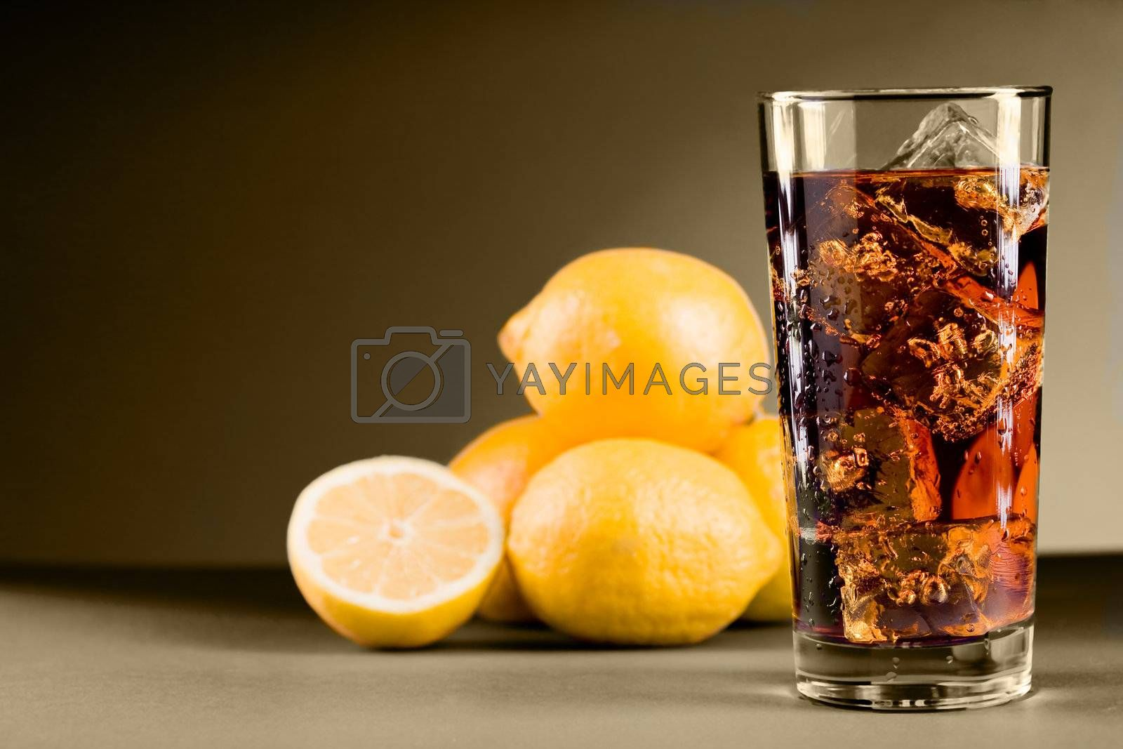 photo of delicious lemon ice team with ice cubes on sepia background
