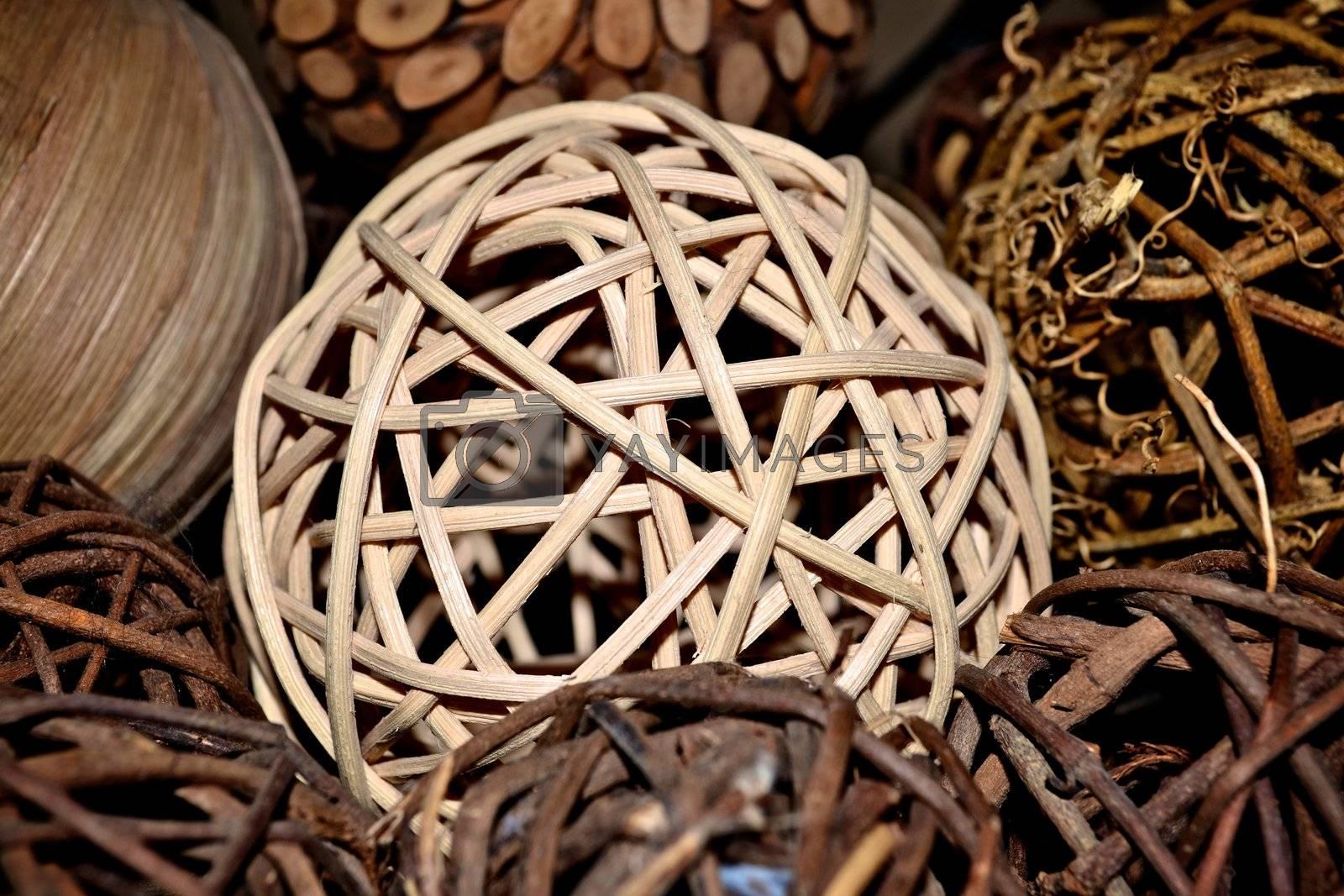 Deorative wicker stick balls in a basket.