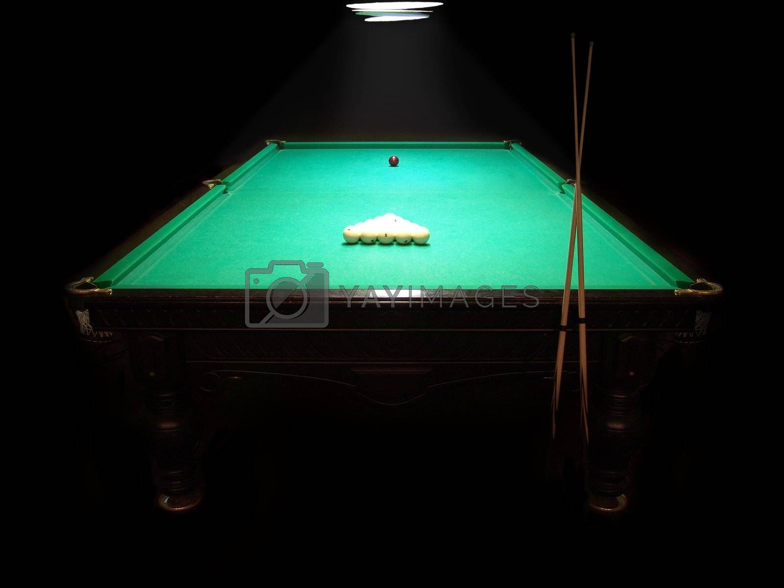 The russian billiard table with a cue and balls on a dark background