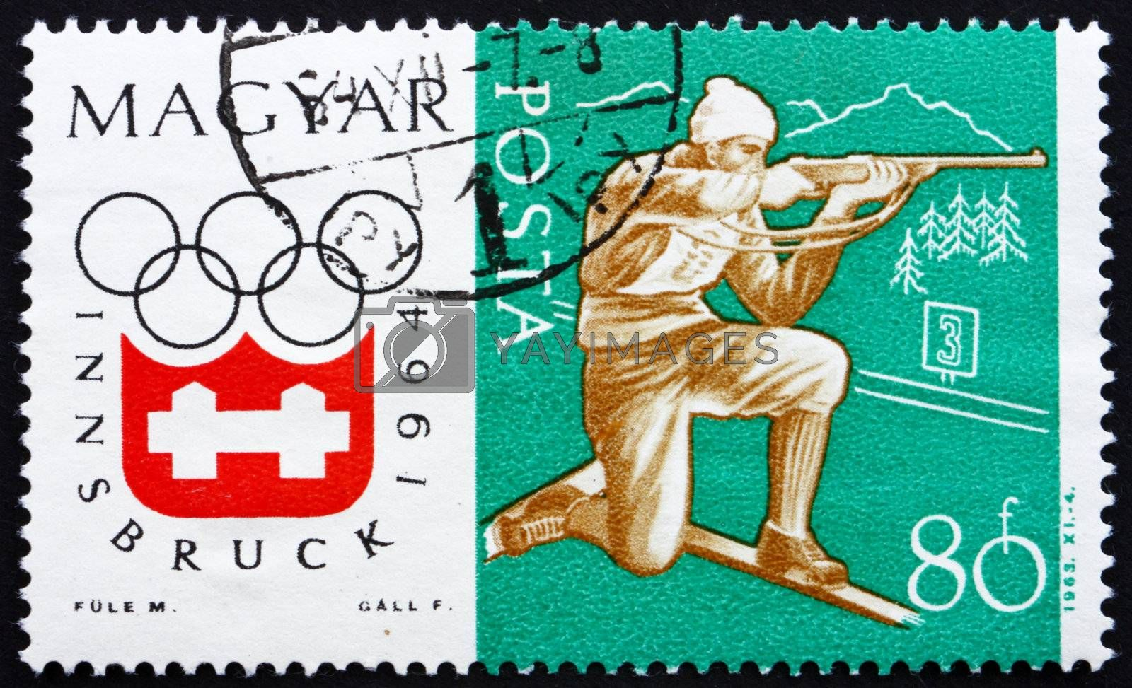 HUNGARY - CIRCA 1963: a stamp printed in the Hungary shows Rifle Shooting on skis, Winter Olympic sports, Innsbruck 64, circa 1963