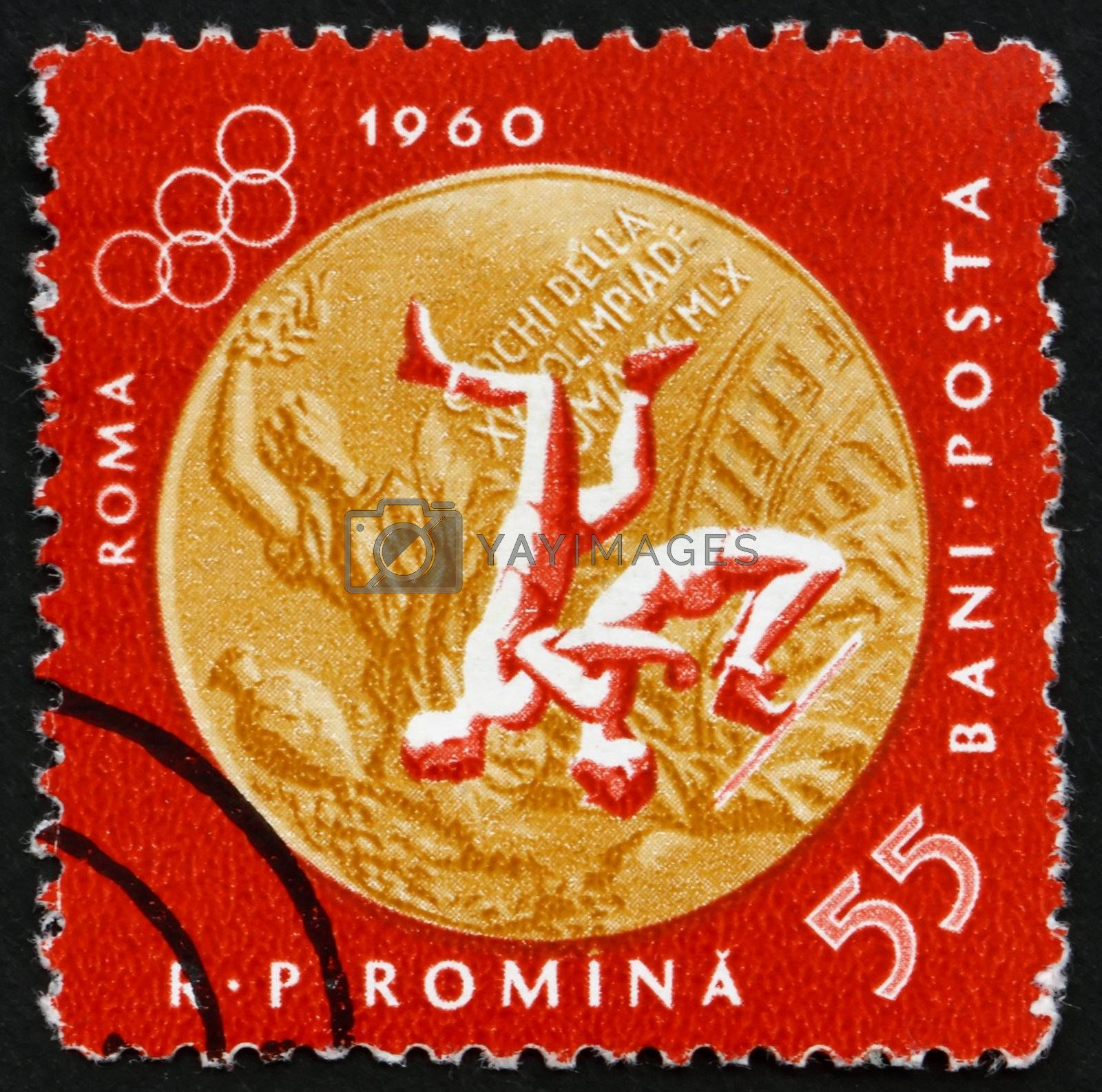 ROMANIA - CIRCA 1961: a stamp printed in the Romania shows Wrestling, Summer Olympic sports, Roma 60, circa 1961