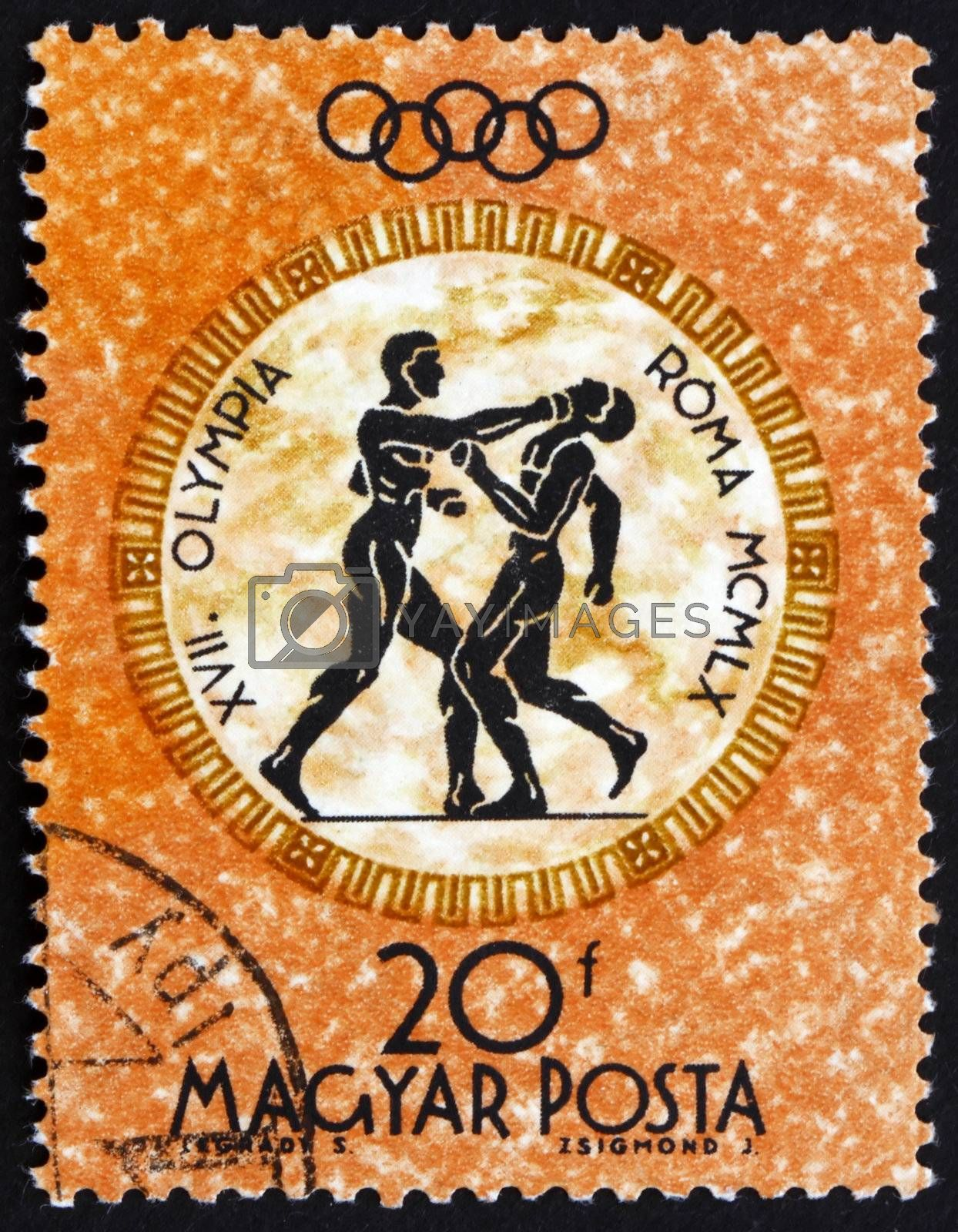 HUNGARY - CIRCA 1960: a stamp printed in the Hungary shows Boxers, Summer Olympic sports, Rome 60, circa 1960