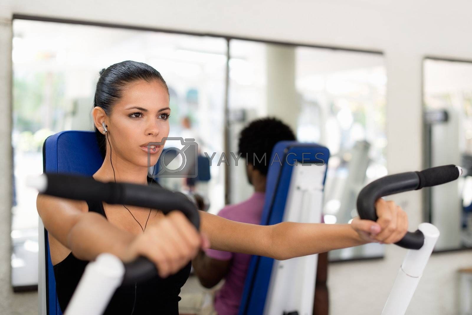 Sport people training and working out in fitness club by diego_cervo