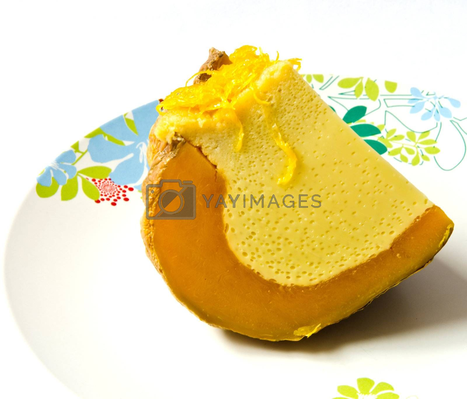 A slice of pumpkin with custard that made of egg,coconut milk,palm sugar