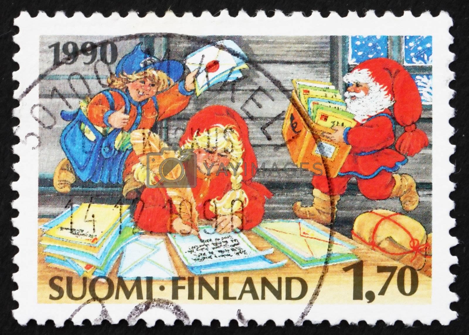 FINLAND - CIRCA 1990: a stamp printed in the Finland shows Santa�s Elves, Christmas, circa 1990