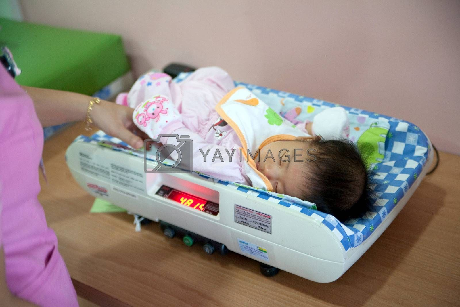 November4,2011:Nursing babies are weighed and the age of 2 months.
