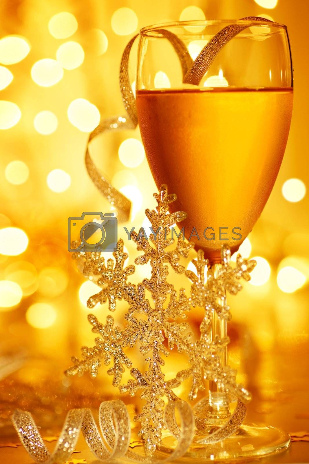 Romantic holiday drink, celebration of Christmas or new year eve, party with Champagne and festive gold ornament decoration