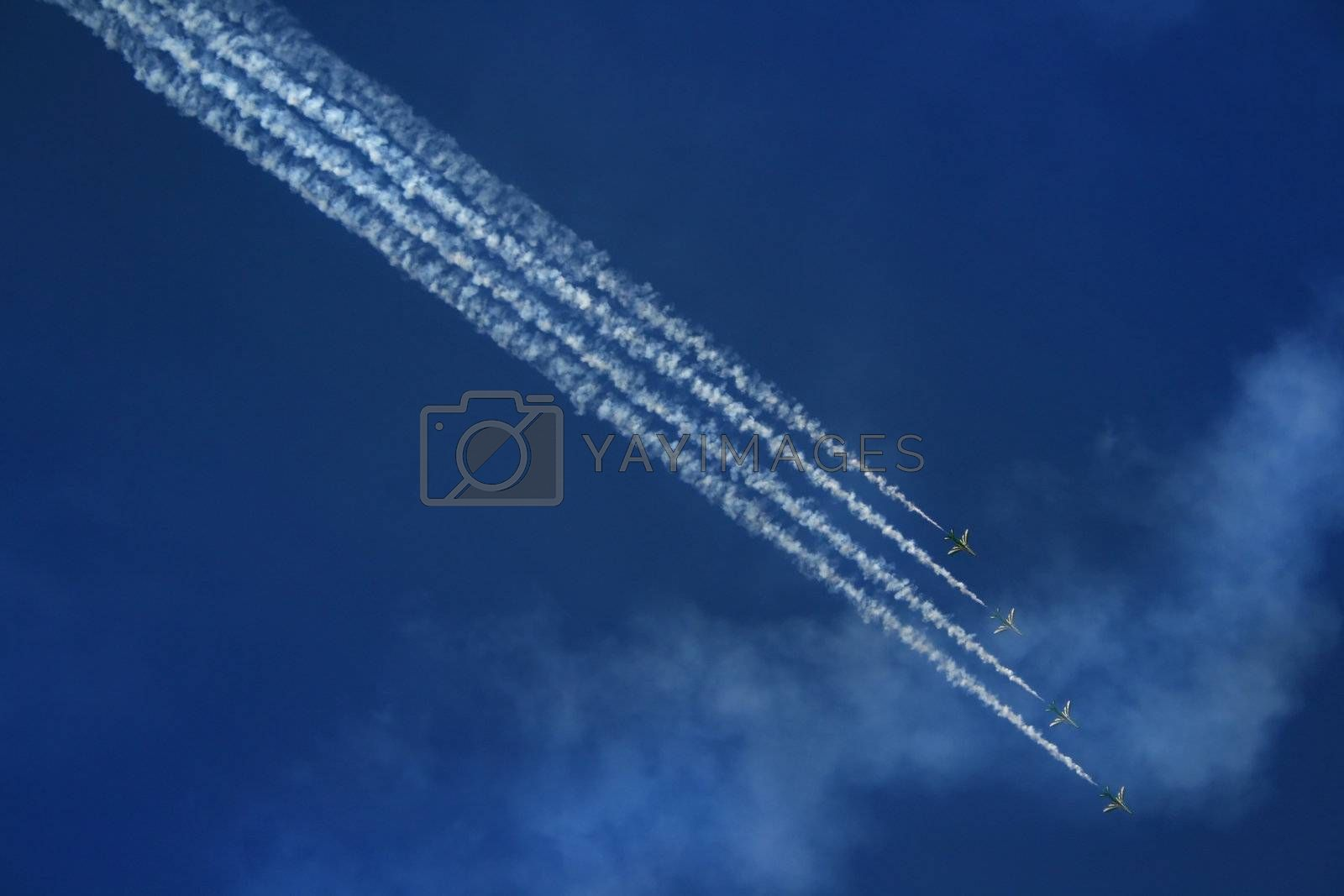 group of four airplanes making formation