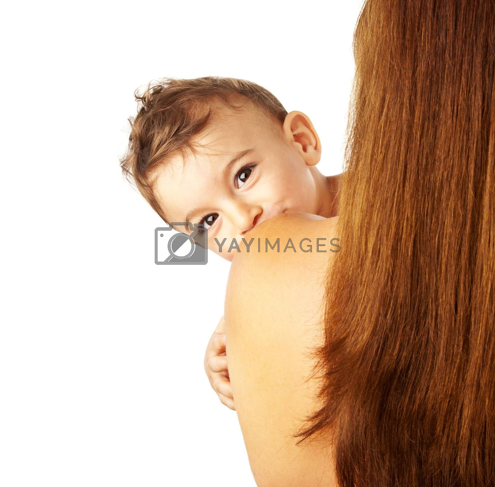 Curious cute baby boy with mother, child looking from shoulder, happy healthy family isolated on white background, brunette rear view, lovely son kissing mom, mommy holding cheerful little kid
